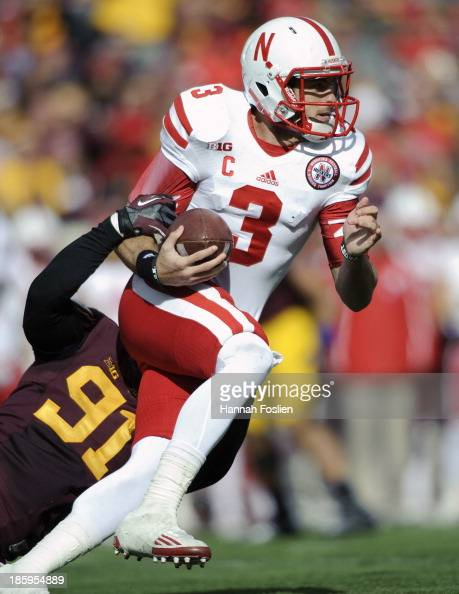 Alex Keith of the Minnesota Golden Gophers sacks Taylor Martinez of the Nebraska Cornhuskers during the third quarter of the game on October 26 2013...