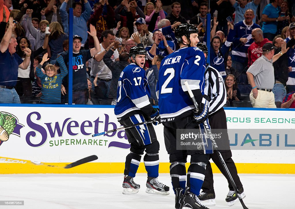 Alex Killorn #17 celebrates after scoring during the third period to tie the game 4-4 at the Tampa Bay Times Forum on March 29, 2013 in Tampa, Florida.