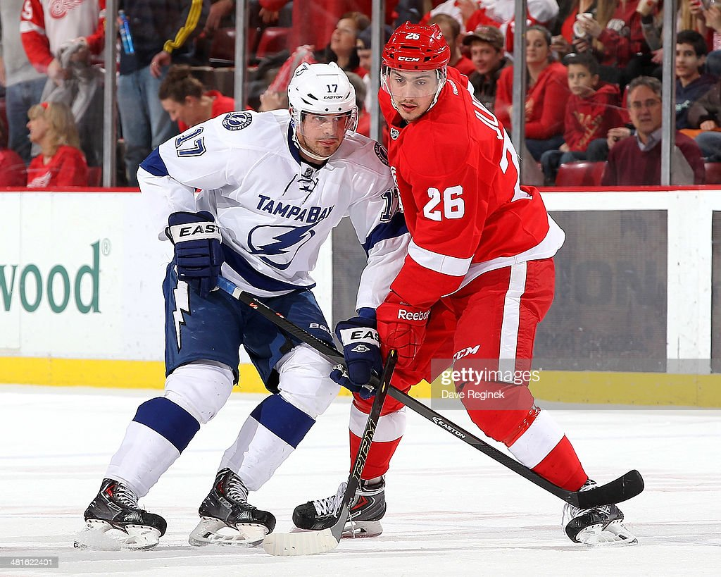 Alex Killorn #17 of the Tampa Bay Lightning and Tomas Jurco #26 of the Detroit Red Wings battle for position on a face-off during an NHL game on March 30, 2014 at Joe Louis Arena in Detroit, Michigan.