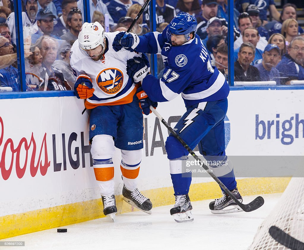 Alex Killorn #17 of the Tampa Bay Lightning battles against <a gi-track='captionPersonalityLinkClicked' href=/galleries/search?phrase=Johnny+Boychuk&family=editorial&specificpeople=2125695 ng-click='$event.stopPropagation()'>Johnny Boychuk</a> #55 of the New York Islanders during the first period of Game Two of the Eastern Conference Second Round in the 2016 NHL Stanley Cup Playoffs at the Amalie Arena on April 30, 2016 in Tampa, Florida.