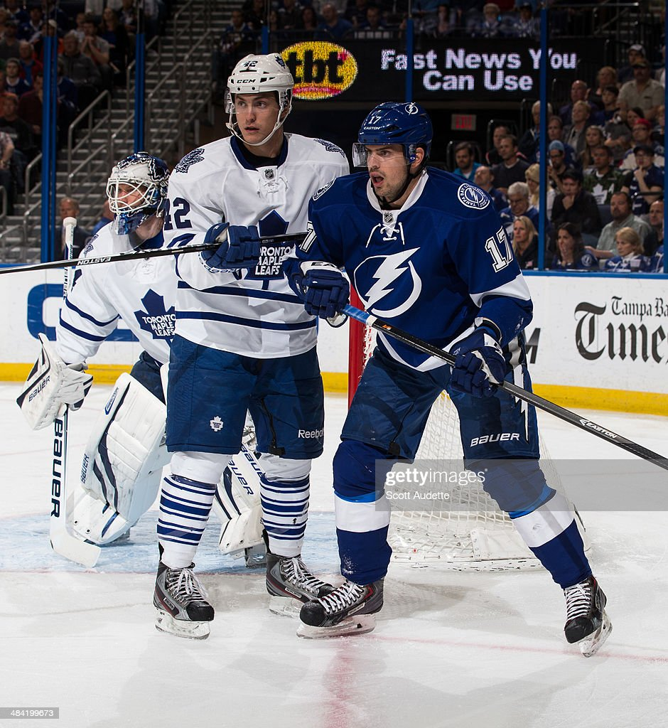 Alex Killorn #17 of the Tampa Bay Lightning battles against <a gi-track='captionPersonalityLinkClicked' href=/galleries/search?phrase=Tyler+Bozak&family=editorial&specificpeople=6183313 ng-click='$event.stopPropagation()'>Tyler Bozak</a> #42 of the Toronto Maple Leafs during the first period at the Tampa Bay Times Forum on April 8, 2014 in Tampa, Florida.