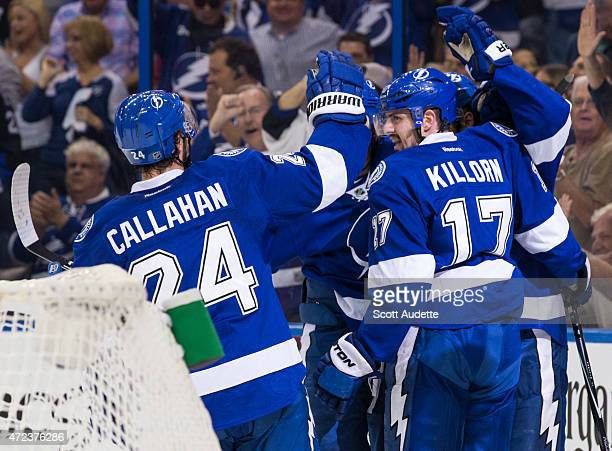 Alex Killorn of the Tampa Bay Lightning celebrates a goal with teammates against the Montreal Canadiens during the first period in Game Three of the...