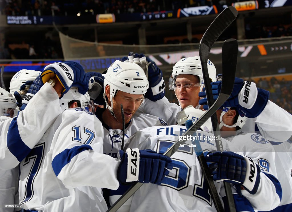 Alex Killorn #17 of the Tampa Bay Lightning celebrates his overtime goal with teammates <a gi-track='captionPersonalityLinkClicked' href=/galleries/search?phrase=Eric+Brewer&family=editorial&specificpeople=202144 ng-click='$event.stopPropagation()'>Eric Brewer</a> #2 and <a gi-track='captionPersonalityLinkClicked' href=/galleries/search?phrase=Valtteri+Filppula&family=editorial&specificpeople=2234404 ng-click='$event.stopPropagation()'>Valtteri Filppula</a> #51 in their game against the Buffalo Sabres at First Niagara Center on October 8, 2013 in Buffalo, New York. Tampa defeated Buffalo 3-2.