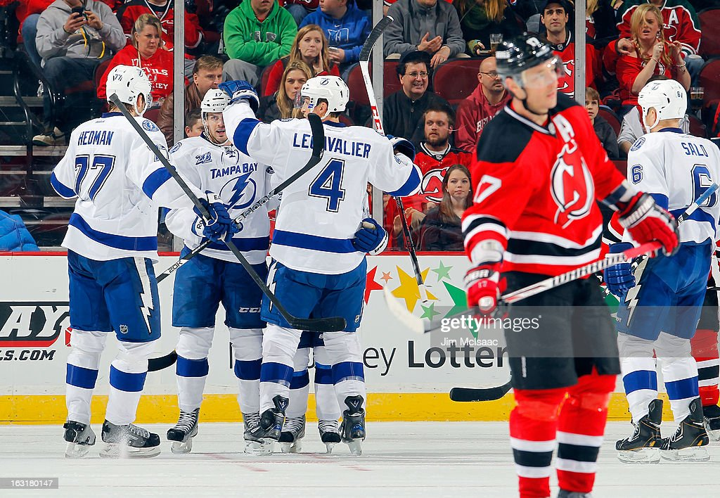 Alex Killorn #17 of the Tampa Bay Lightning celebrates his second period goal against the New Jersey Devils with his teammates at the Prudential Center on March 5, 2013 in Newark, New Jersey.
