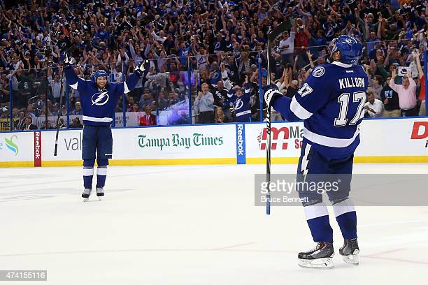 Alex Killorn of the Tampa Bay Lightning celebrates with his teammates after scoring a goal in the second period against Henrik Lundqvist of the New...