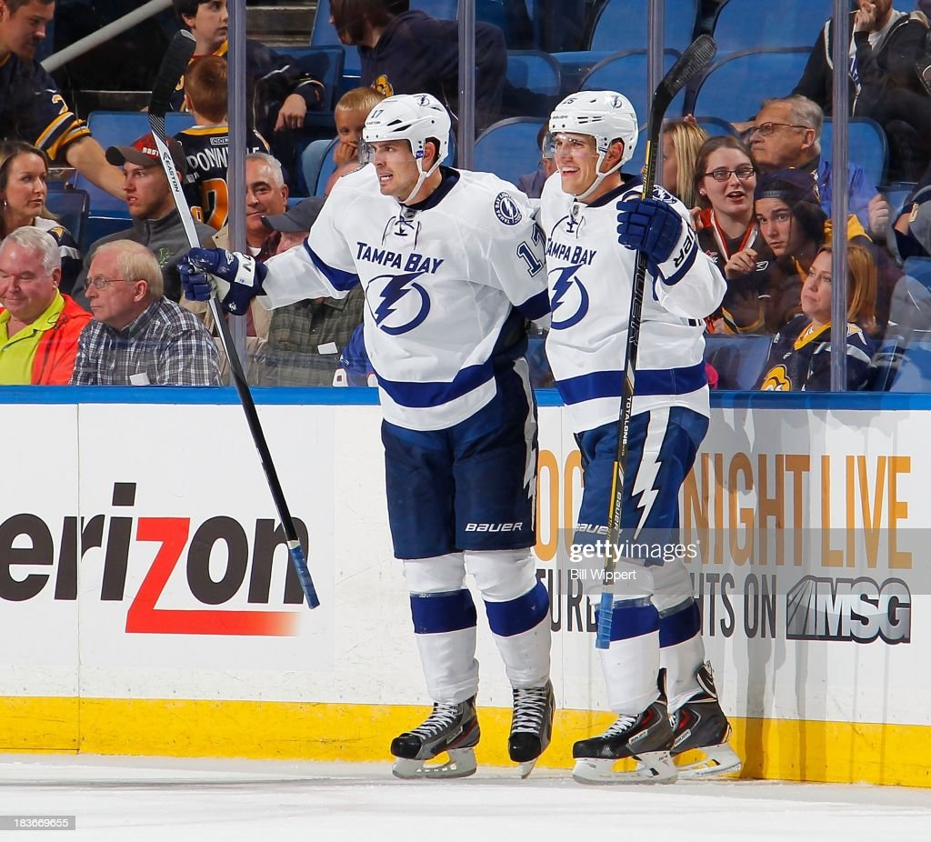 Alex Killorn #17 of the Tampa Bay Lightning celebrates with Matthew Carle #25 after scoring the game winning overtime goal against the Buffalo Sabres on October 8, 2013 at the First Niagara Center in Buffalo, New York. Tampa Bay won, 3-2.