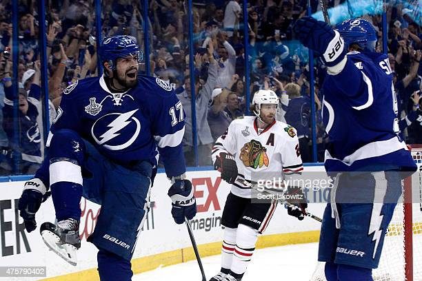 Alex Killorn of the Tampa Bay Lightning celebrates with Steven Stamkos after scoring his first period goal against the Chicago Blackhawks during Game...