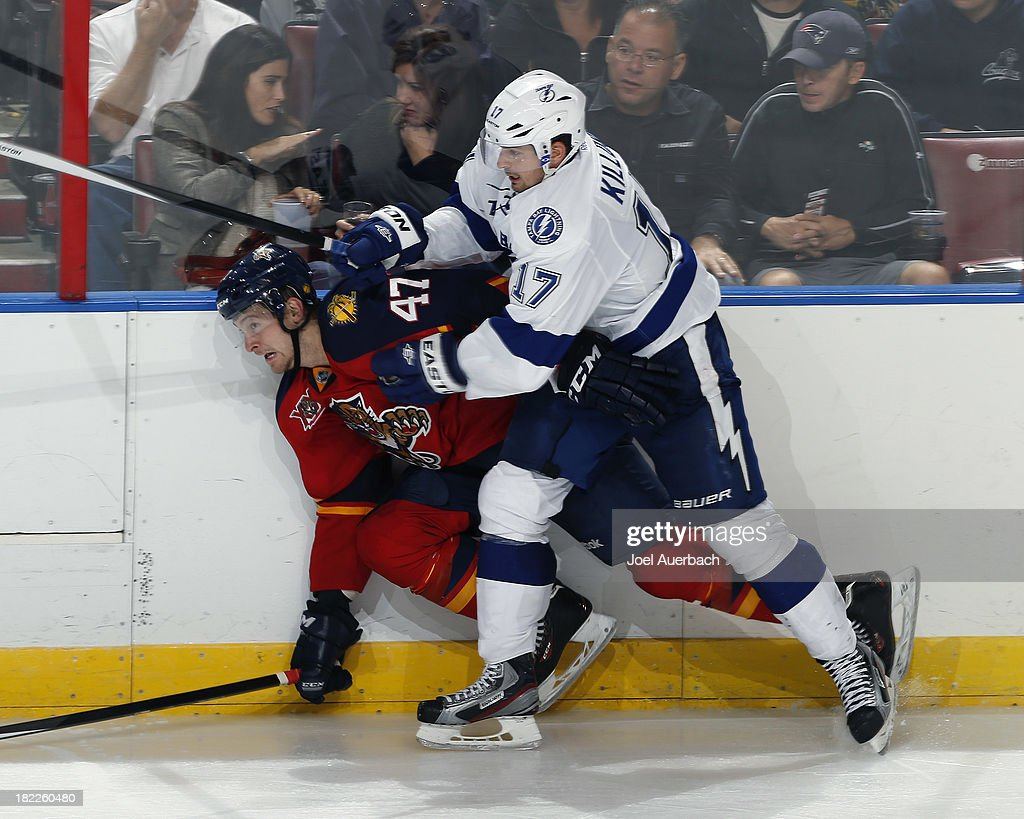 Alex Killorn #17 of the Tampa Bay Lightning checks <a gi-track='captionPersonalityLinkClicked' href=/galleries/search?phrase=Colby+Robak&family=editorial&specificpeople=4898162 ng-click='$event.stopPropagation()'>Colby Robak</a> #47 of the Florida Panthers at the BB&T Center on September 28, 2013 in Sunrise, Florida. The Panthers defeated the Lightning 5-3.