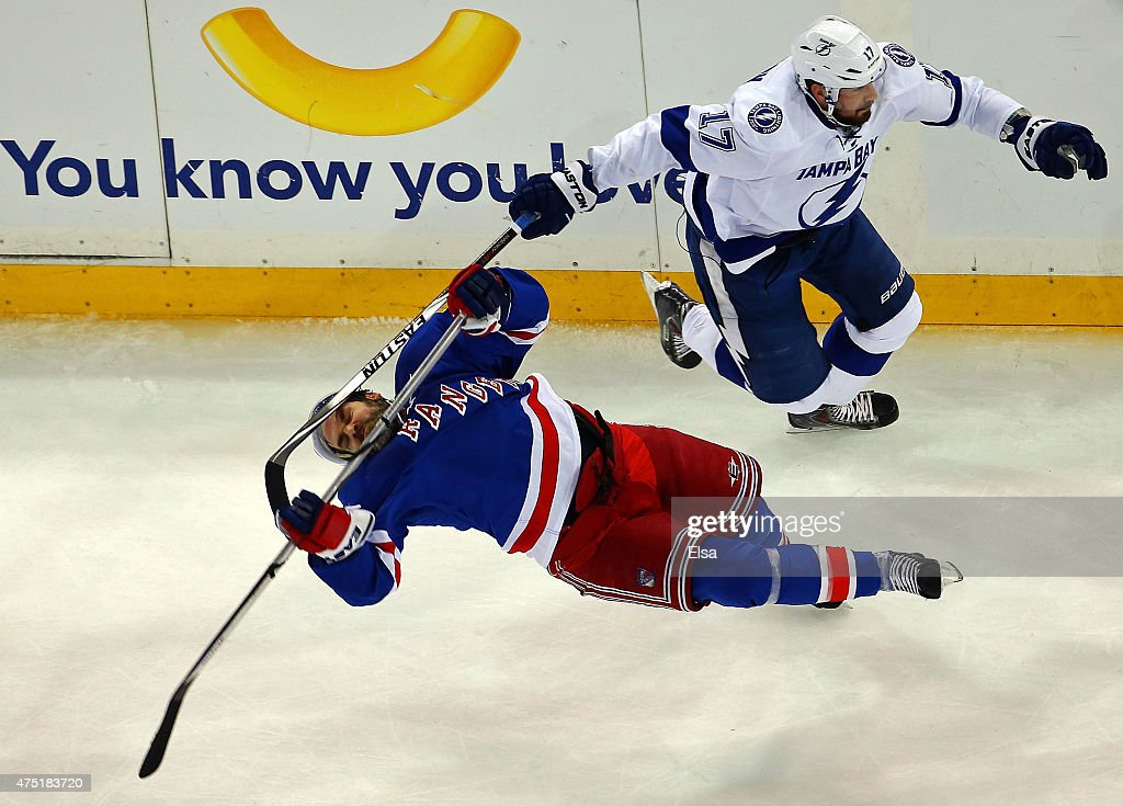 Alex Killorn #17 of the Tampa Bay Lightning collides with Dan Boyle #22 of the New York Rangers in the first period of Game Seven of the Eastern Conference Finals during the 2015 NHL Stanley Cup Playoffs at Madison Square Garden on May 29, 2015 in New York City.