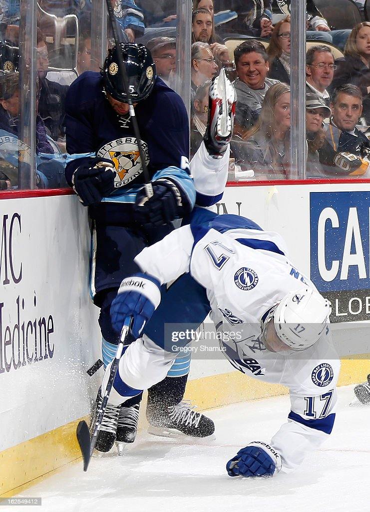 Alex Killorn #17 of the Tampa Bay Lightning collides with Deryk Engelland #5 of the Pittsburgh Penguins on February 24, 2013 at Consol Energy Center in Pittsburgh, Pennsylvania.