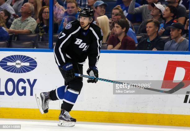 Alex Killorn of the Tampa Bay Lightning defends against the Toronto Maple Leafs during the first period at Amalie Arena on December 29 2016 in Tampa...