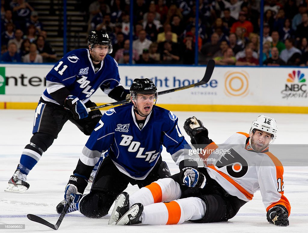 Alex Killorn #17 of the Tampa Bay Lightning looks at the play after falling on top of <a gi-track='captionPersonalityLinkClicked' href=/galleries/search?phrase=Simon+Gagne&family=editorial&specificpeople=201772 ng-click='$event.stopPropagation()'>Simon Gagne</a> #12 of the Philadelphia Flyers during the third period of the game at the Tampa Bay Times Forum on March 18, 2013 in Tampa, Florida.