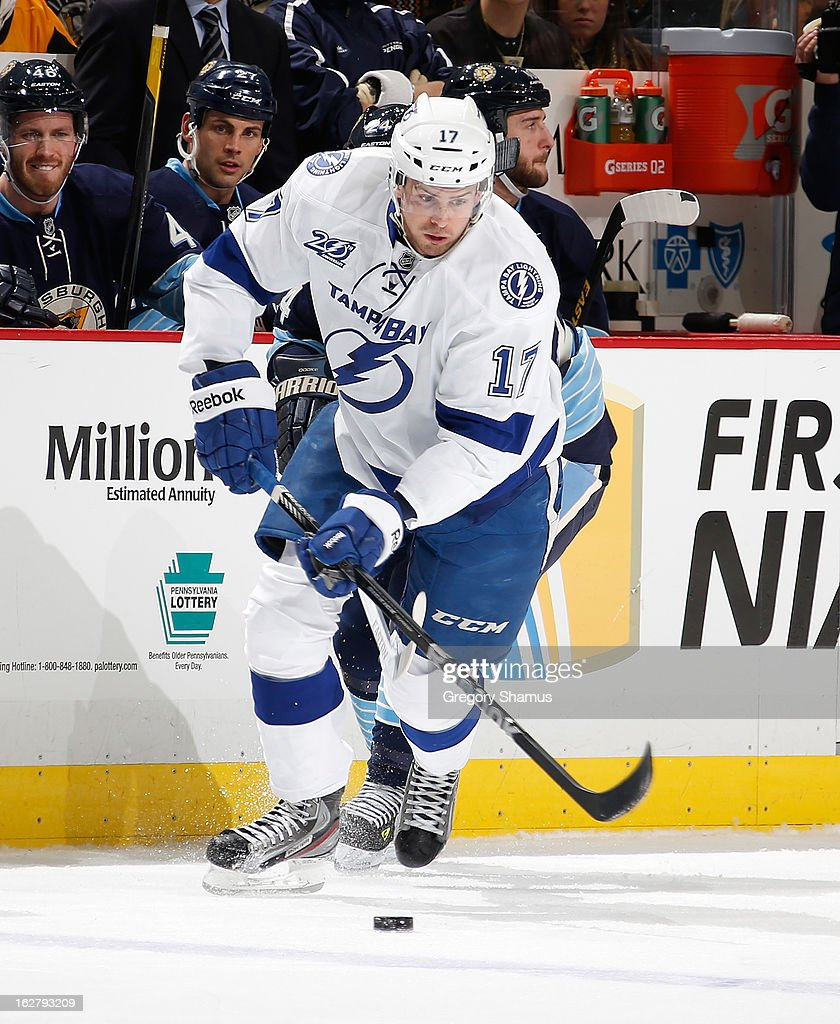 Alex Killorn #17 of the Tampa Bay Lightning moves the puck against the Pittsburgh Penguins on February 24, 2013 at Consol Energy Center in Pittsburgh, Pennsylvania.