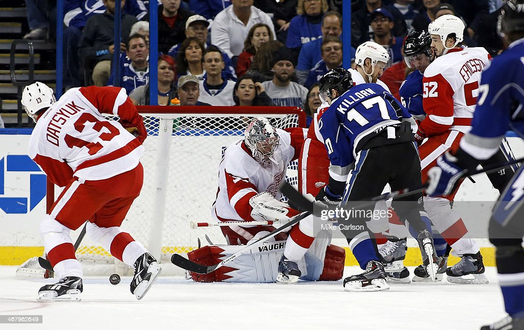 Alex Killorn #17 of the Tampa Bay Lightning scores past <a gi-track='captionPersonalityLinkClicked' href=/galleries/search?phrase=Jimmy+Howard&family=editorial&specificpeople=2118637 ng-click='$event.stopPropagation()'>Jimmy Howard</a> #35 of the Detroit Red Wings at the Tampa Bay Times Forum on February 8, 2014 in Tampa, Florida.