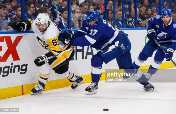 Alex Killorn of the Tampa Bay Lightning skates against Phil Kessel of the Pittsburgh Penguins during the second period at Amalie Arena on October 12...