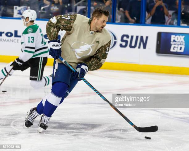 Alex Killorn of the Tampa Bay Lightning wears a Military Appreciation Night jersey for pregame warm ups against the Dallas Stars at Amalie Arena on...