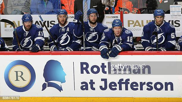 Alex Killorn Ryan Callahan Tyler Johnson Ondrej Palat and Valtteri Filppula of the Tampa Bay Lightning watch the play on the ice from their bench...
