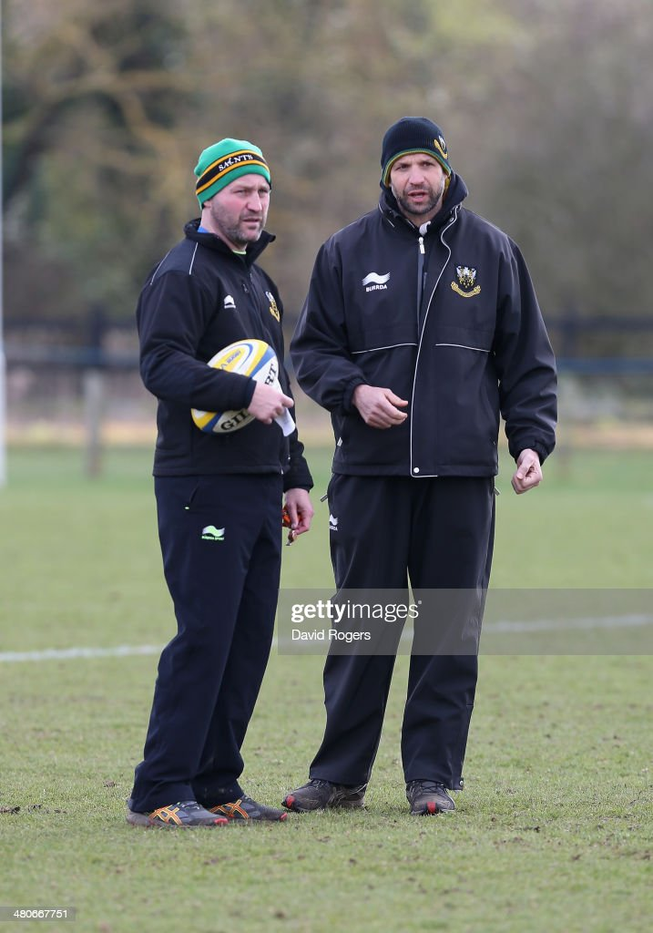 Alex King the backs coach and director of rugby Jim Mallinder look on during the Northampton Saints training session held at Franklin's Gardens on...