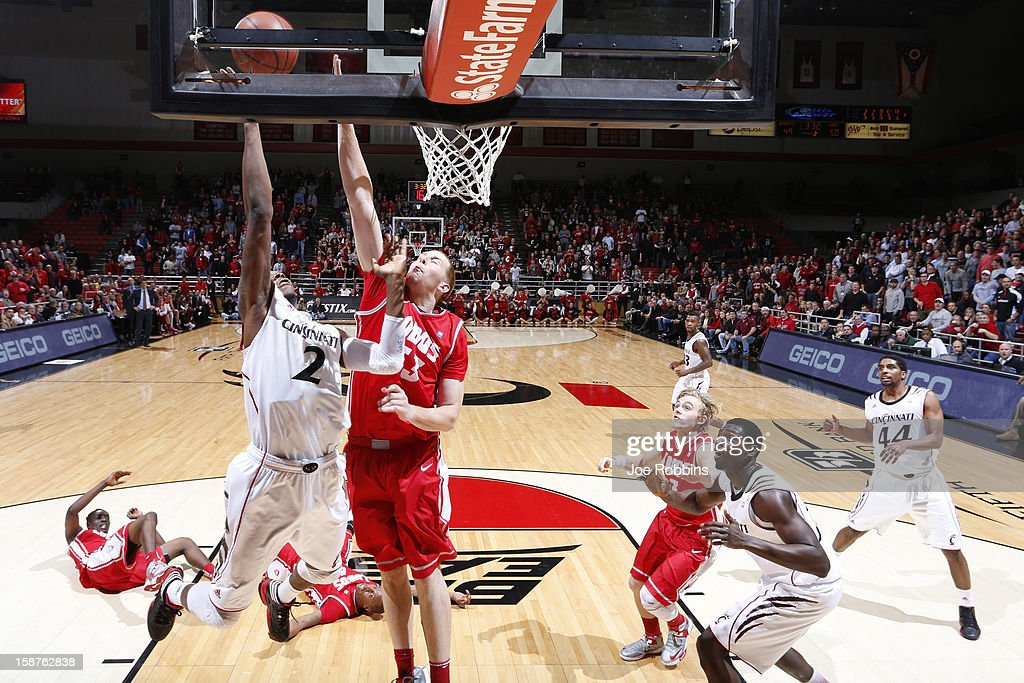 Alex Kirk #53 of the New Mexico Lobos defends the basket against Titus Rubles #2 of the Cincinnati Bearcats during the game at Fifth Third Arena on December 27, 2012 in Cincinnati, Ohio. New Mexico won 55-54.