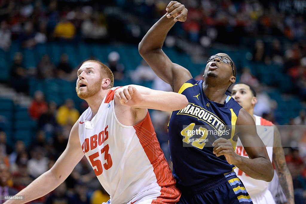 Alex Kirk #53 of the New Mexico Lobos fights for position against Chris Otule #42 of the Marquette Golden Eagles during their game at the MGM Grand Garden Arena on December 21, 2013 in Las Vegas, Nevada. New Mexico won 75-68.