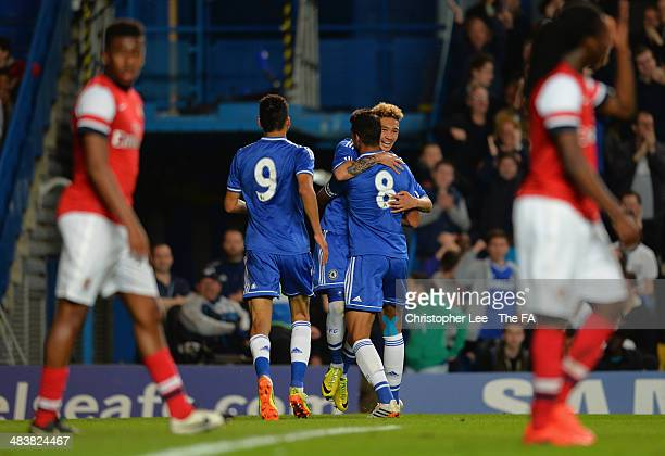 Alex Kiwomya of Chelsea celebrates scoring their second goal with team mates during the FA Youth Cup Semi Final First Leg match between Chelsea U18...