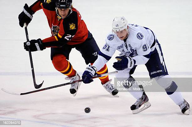 Alex Kovalev of the Florida Panthers and Steven Stamkos of the Tampa Bay Lightning go after the puck during a NHL game against the Florida Panthers...