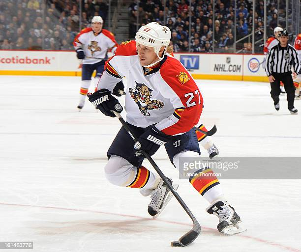 Alex Kovalev of the Florida Panthers plays the puck during third period action against the Winnipeg Jets at the MTS Centre on February 5 2013 in...