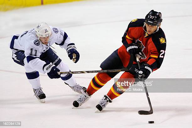 Alex Kovalev of the Florida Panthers skates with the puck as Tom Pyatt of the Tampa Bay Lightning chases during a NHL game at the BBT Center on...