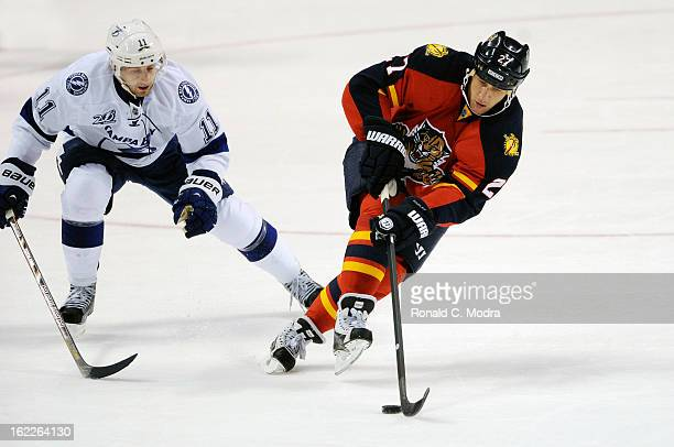 Alex Kovalev of the Florida Panthers skates with the puck during a NHL game against the Tampa Bay Lightning at the BBT Center on February 16 2013 in...