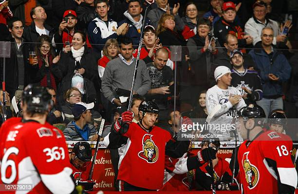 Alex Kovalev of the Ottawa Senators salutes the crowd during a standing ovation celebrating his 1000th NHL regular season point during a game against...
