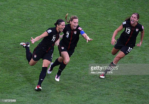 Alex Krieger of USA celebrates with Christie Rampone and Alex Morgan after scoring the winning penalty in the penalty shoot out during the FIFA...