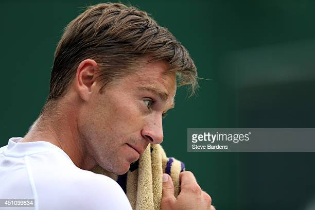 Alex Kuznetsov of the United States reacts during his Gentlemen's Singles first round match against Fabio Fognini of Italy on day one of the...