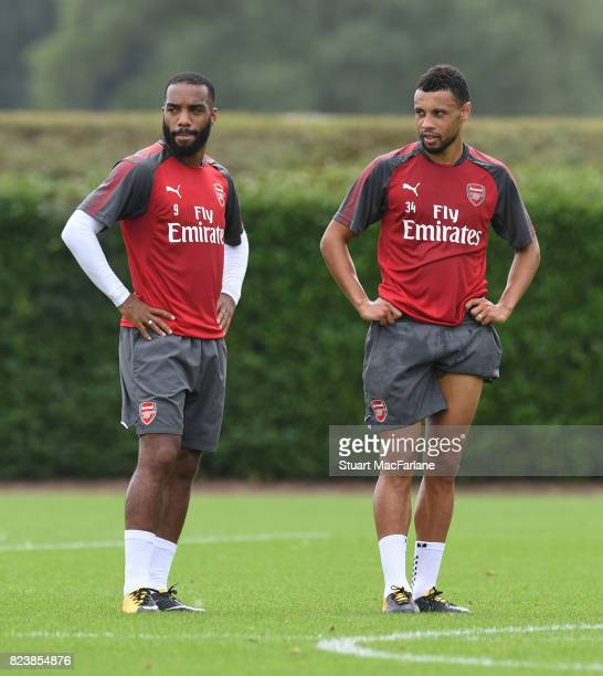 Alex Lacazette and Francis Coquelin of Arsenal during a training session at London Colney on July 28 2017 in St Albans England