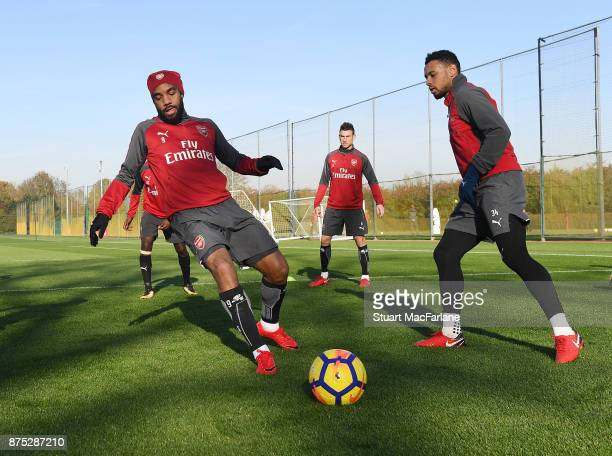 Alex Lacazette and Francis Coquelin of Arsenal during a training session at London Colney on November 17 2017 in St Albans England