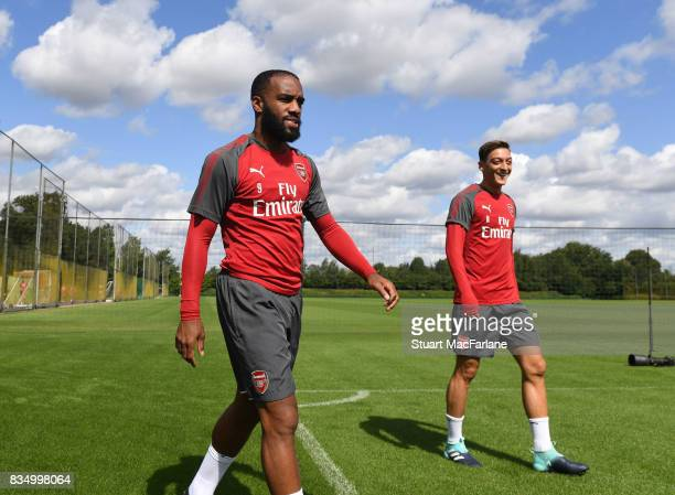 Alex Lacazette and Mesut Ozil of Arsenal before a training session at London Colney on August 18 2017 in St Albans England