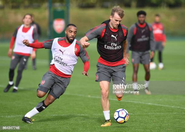 Alex Lacazette and Rob Holding of Arsenal during a training session at London Colney on October 21 2017 in St Albans England