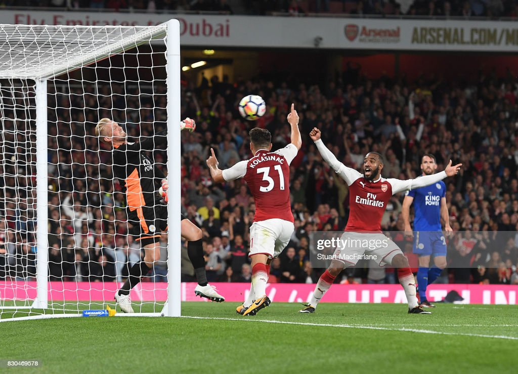 Alex Lacazette and (2ndR) Sead Kolasinac celebrate the 3rd Arsenal goal as Leicester goalkeeper (L) Kasper Schmeichel looks on during the Premier League match between Arsenal and Leicester City at Emirates Stadium on August 11, 2017 in London, England.