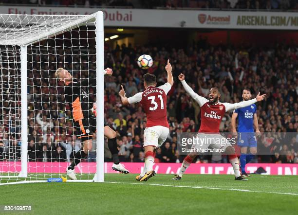 Alex Lacazette and Sead Kolasinac celebrate the 3rd Arsenal goal as Leicester goalkeeper Kasper Schmeichel looks on during the Premier League match...
