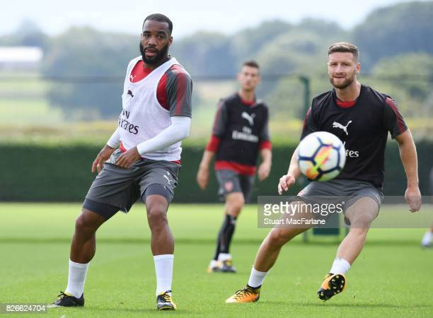 Alex Lacazette and Shkodran Mustafi of Arsenal during a training session at London Colney on August 5 2017 in St Albans England