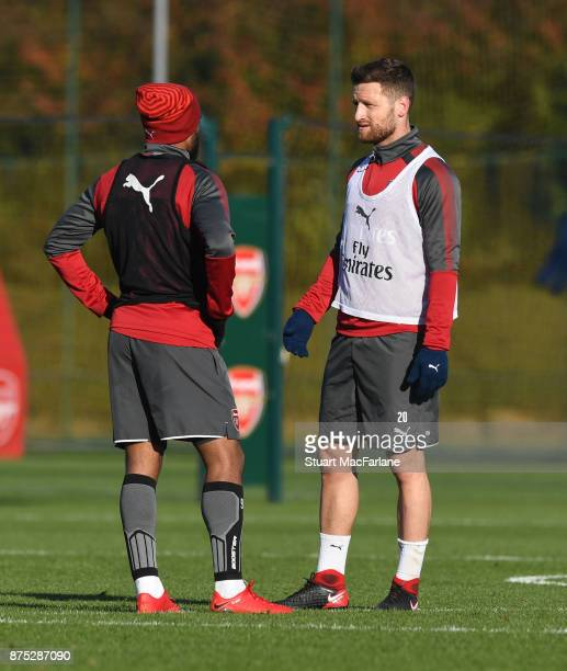 Alex Lacazette and Shkodran Mustafi of Arsenal during a training session at London Colney on November 17 2017 in St Albans England