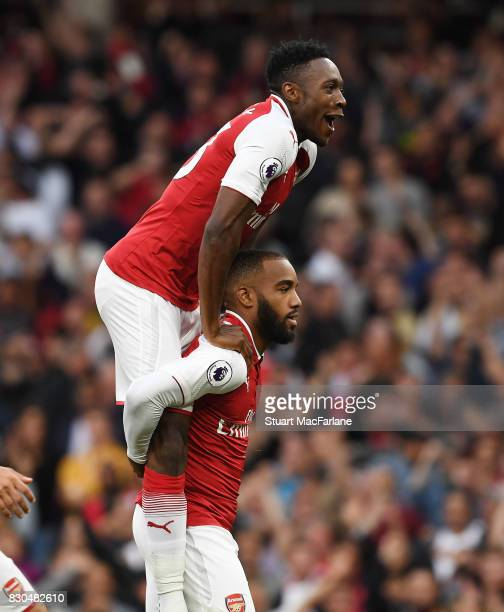 Alex Lacazette celebrates scoring the 1st Arsenal goal with Danny Welbeck during the Premier League match between Arsenal and Leicester City at...