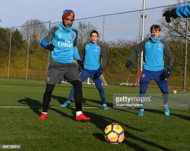 Alex Lacazette Hector Bellerin and Nacho Monreal of Arsenal during a training session at London Colney on December 9 2017 in St Albans England