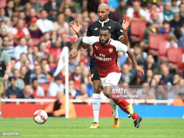 Alex Lacazette of Arsenal breaks past Steve N'Zonzi of Seville during the Emirates Cup match between Arsenal and Seville at Emirates Stadium on July...