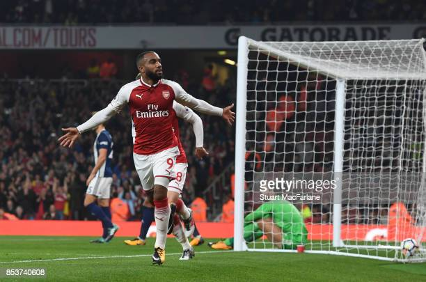 Alex Lacazette of Arsenal celebrates after scoring the opening goal during the Premier League match between Arsenal and West Bromwich Albion at...