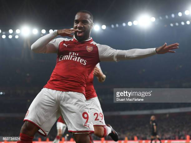Alex Lacazette of Arsenal celebrates scoring for Arsenal during the Premier League match between Arsenal and West Bromwich Albion at Emirates Stadium...