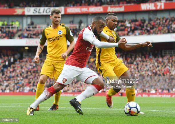 Alex Lacazette of Arsenal challenged by Jose Izquierdo of Brighton during the Premier League match between Arsenal and Brighton and Hove Albion at...
