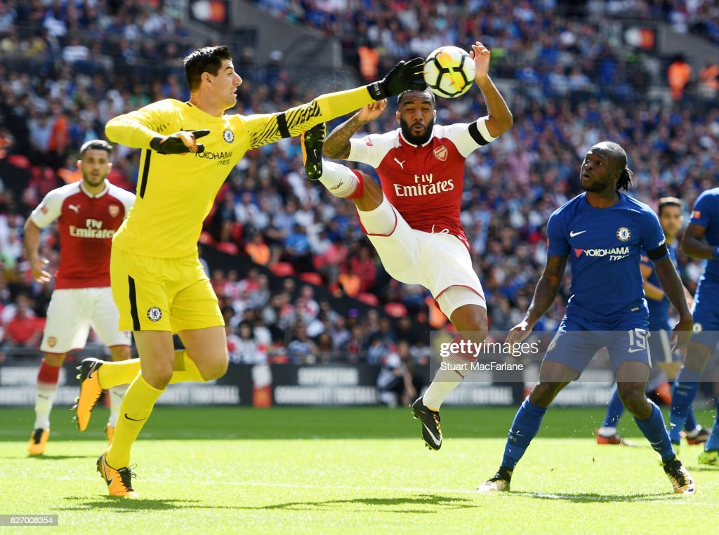 Alex Lacazette of Arsenal challenges Thibaut Courtois of Chelsea during the FA Community Shield match between Chelsea and Arsenal at Wembley Stadium on August 6, 2017 in London, England.