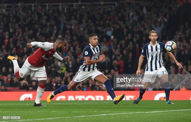 Alex Lacazette of Arsenal scores the opening goal during the Premier League match between Arsenal and West Bromwich Albion at Emirates Stadium on...