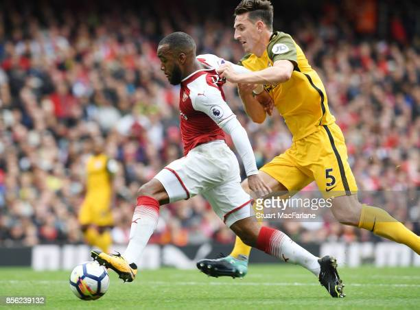 Alex Lacazette of Arsenal takes on Lewis Dunk of Brighton during the Premier League match between Arsenal and Brighton and Hove Albion at Emirates...