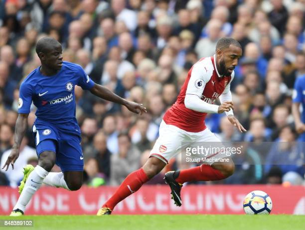 Alex Lacazette of Arsenal takes on N'Golo Kante of Chelsea during the Premier League match between Chelsea and Arsenal at Stamford Bridge on...